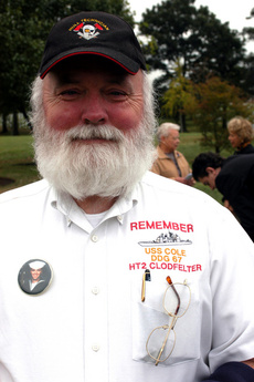 John Clodfelter wears a shirt commemorating the USS Cole and his son, <br> Petty Officer 2nd Class Kenneth E. Clodfelter, who was killed in the <br> Oct. 12, 2000, terrorist attack on the guided missile destroyer. <br> Photo by Rudi Williams