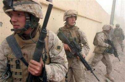 Waynesberg, Pa. native Lance Cpl. Steven L. Phillips, left, <br> followed by Albany, N.Y., native Lance Cpl. Paul J. Kolkhorst with Company I, <br> 3rd Battalion, 6th Marine Regiment, Regimental Combat Team 2, in Nov. 15, <br> 2005. (AP Photo/ U.S. Marine Corps, Sgt. Jerad W. Alexander)