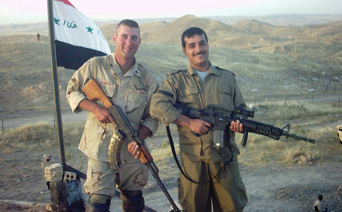 David was in my platoon in Iraq. In this photo he is with an Iraqi <br> soldier whose unit invited our platoon to dinner. Everyone who knew <br> David respected him and loved him. He made friends everywhere he <br> went, but he was a quite person. He understood people, and always <br> found good in them.